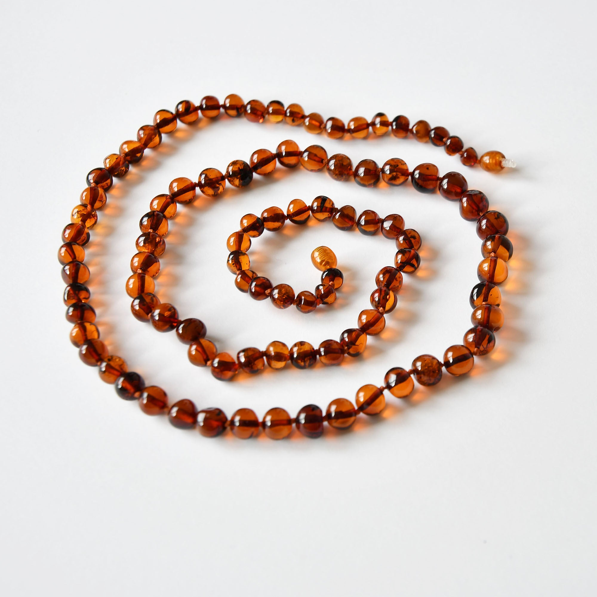 Amber beads necklace of cherry color