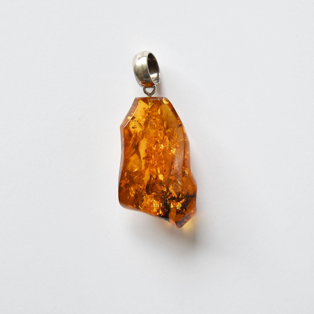 Dark orange color amber pendant with silver