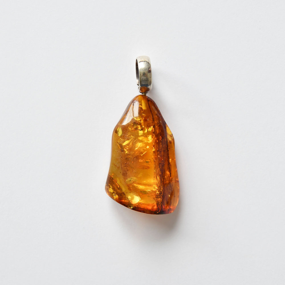 Dark orange color amber pendant