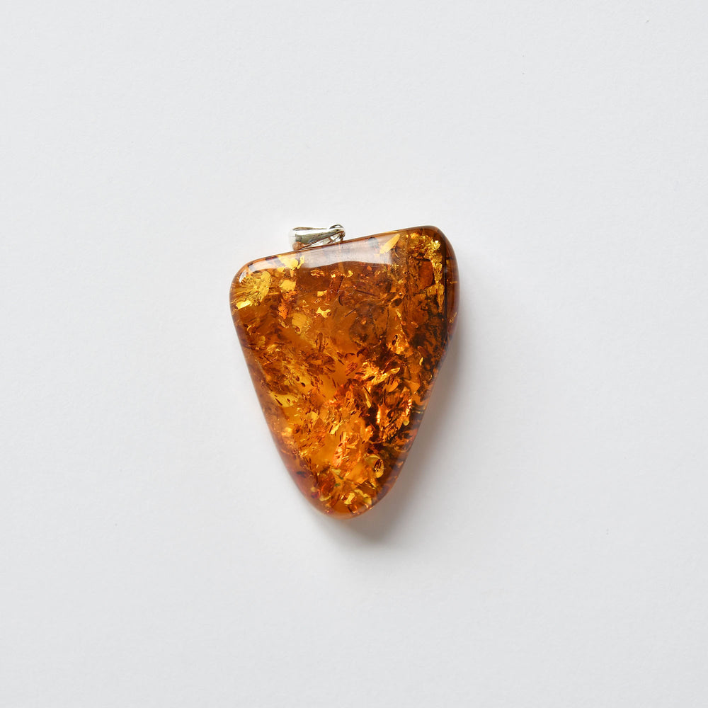 Amber pendant of gold and red