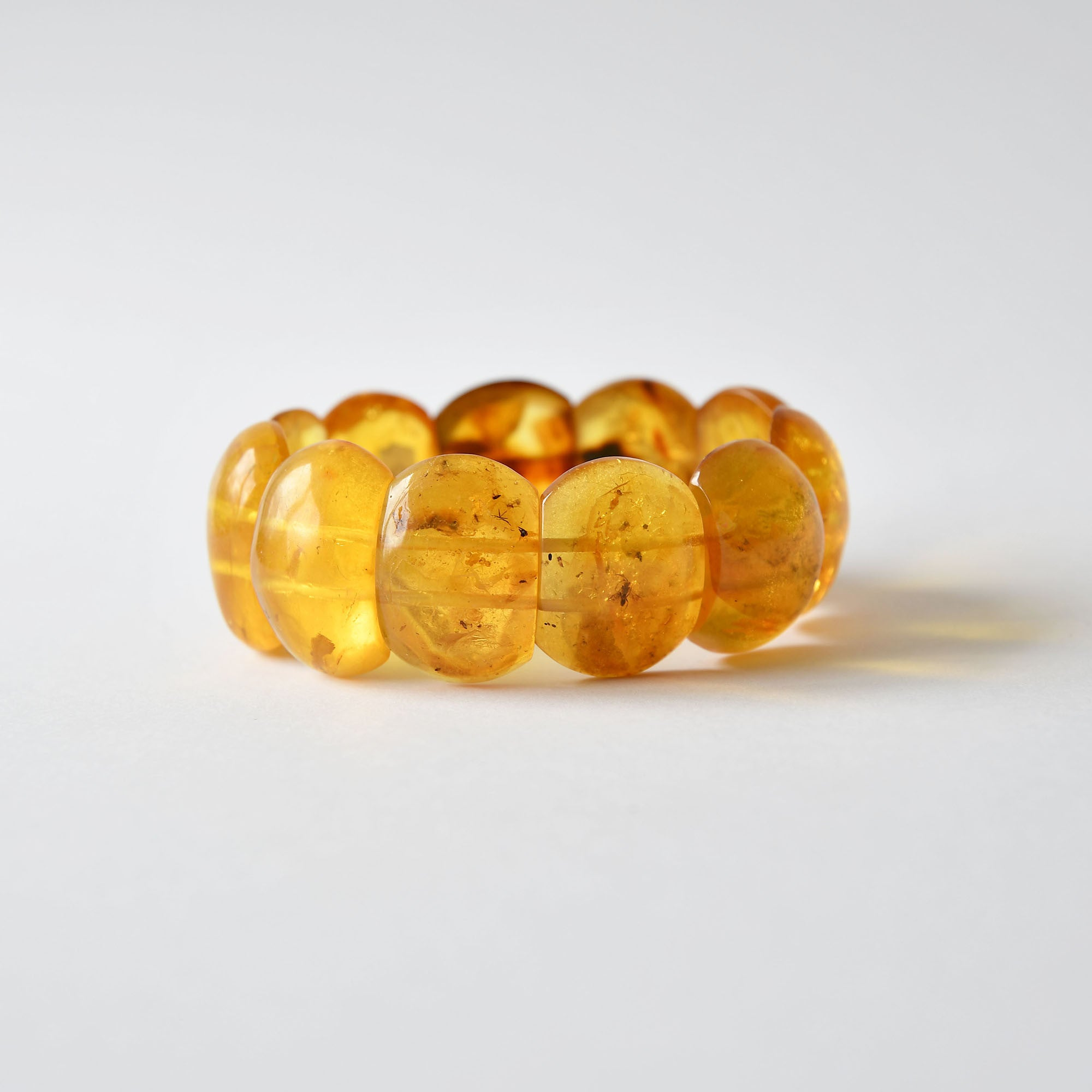 Yellow amber bracelet with inclusion