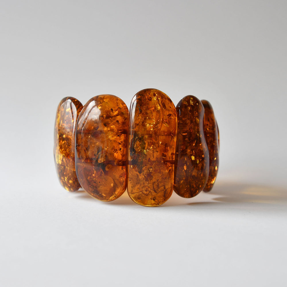 Amber bracelet of brandy colour on an elastic band