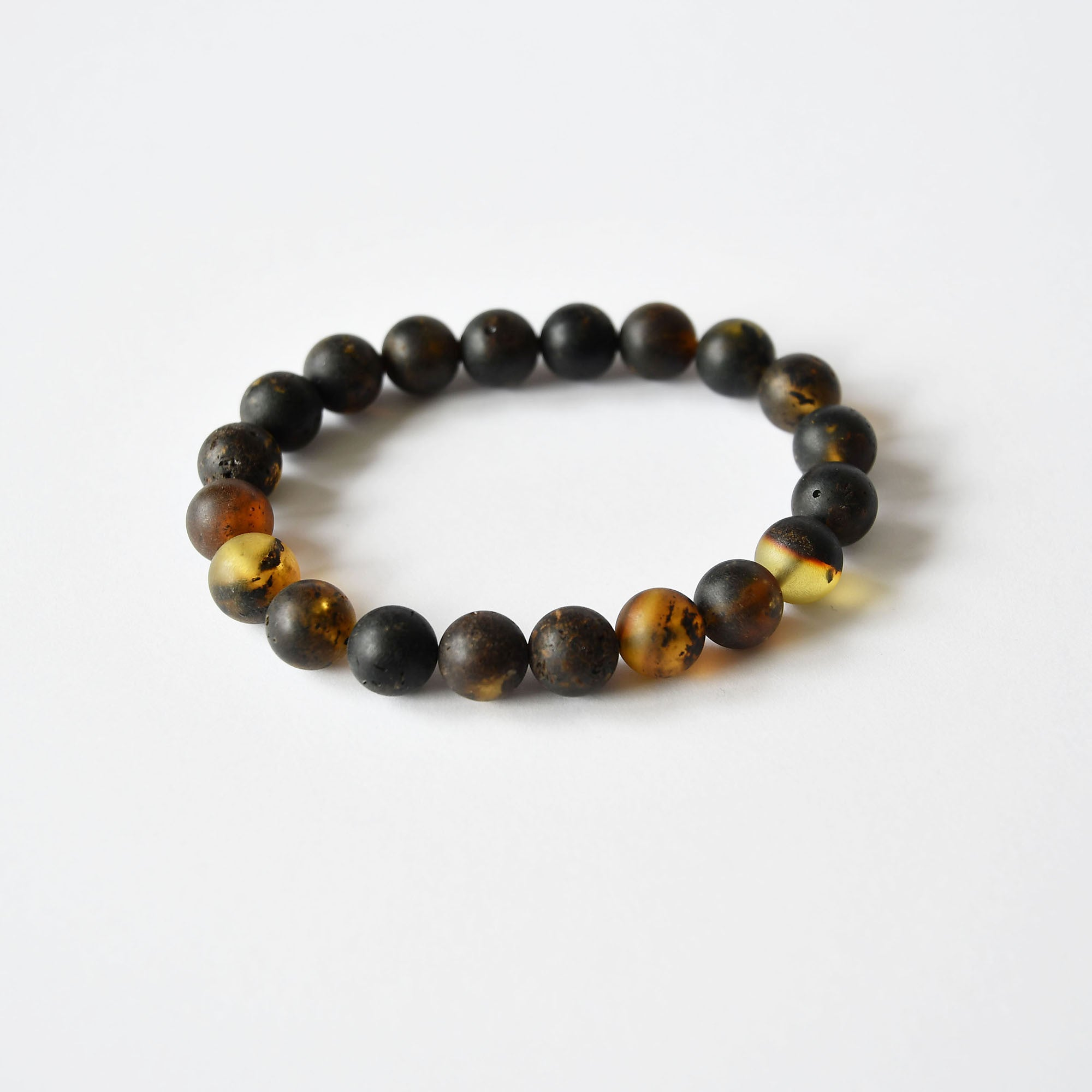 Black amber bracelet of round beads with elastic band