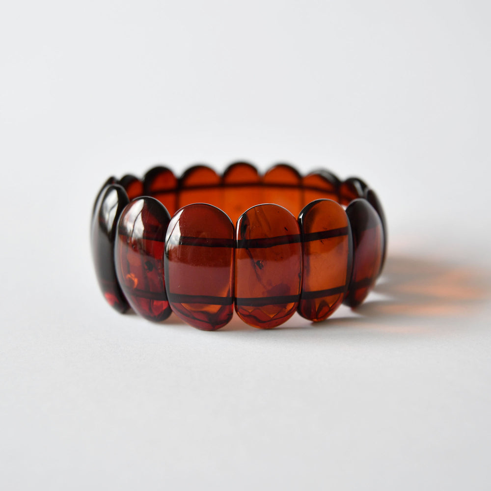 Amber bracelet of cherry color on an elastic band
