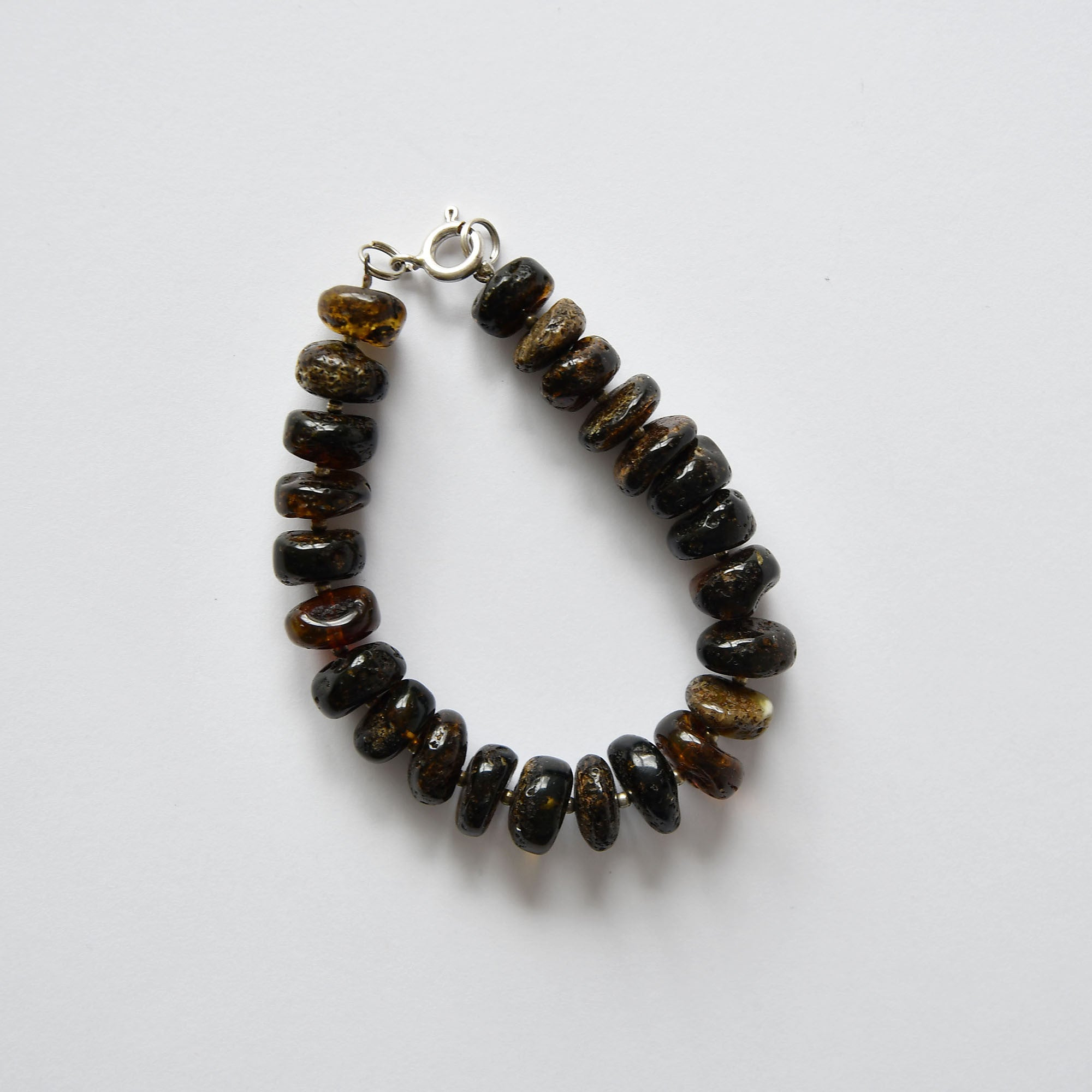 Black amber bracelet with a fastening