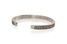 "Pave  2 rows C.Z.in center of this beautiful 1/4"" cuff bracelet signature logos on outside of each end .Silver plated"