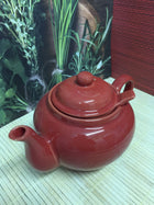 red ceramic teapot