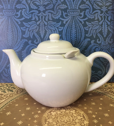 white ceramic teapot