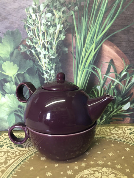 one cup teapot with a cup purple