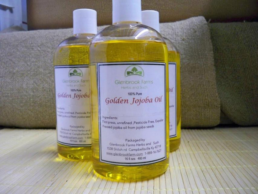 Golden jojoba oil in a bottle