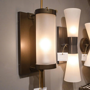 arteriors home Stefan wall sconce bronze frosted glass showroom