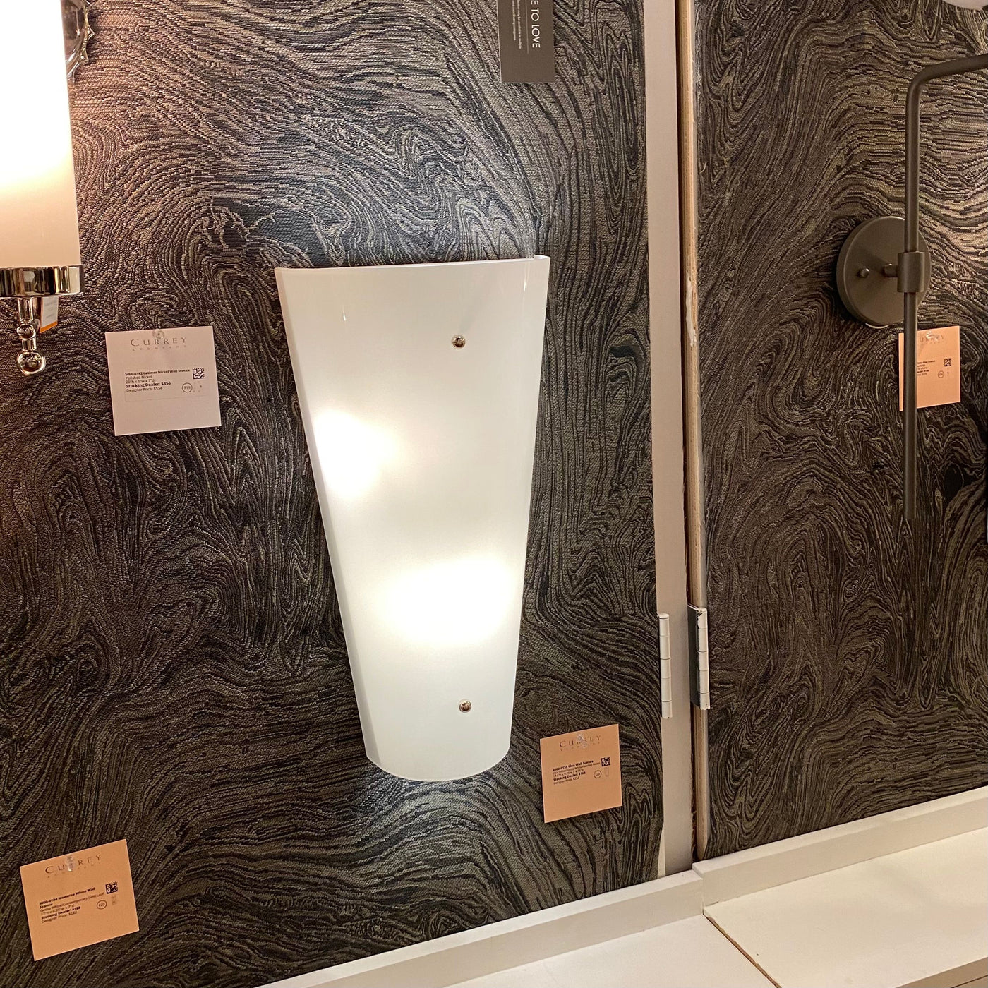 currey and company cleo wall sconce showroom