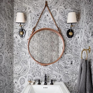 Jamie Young large round brass mirror bathroom