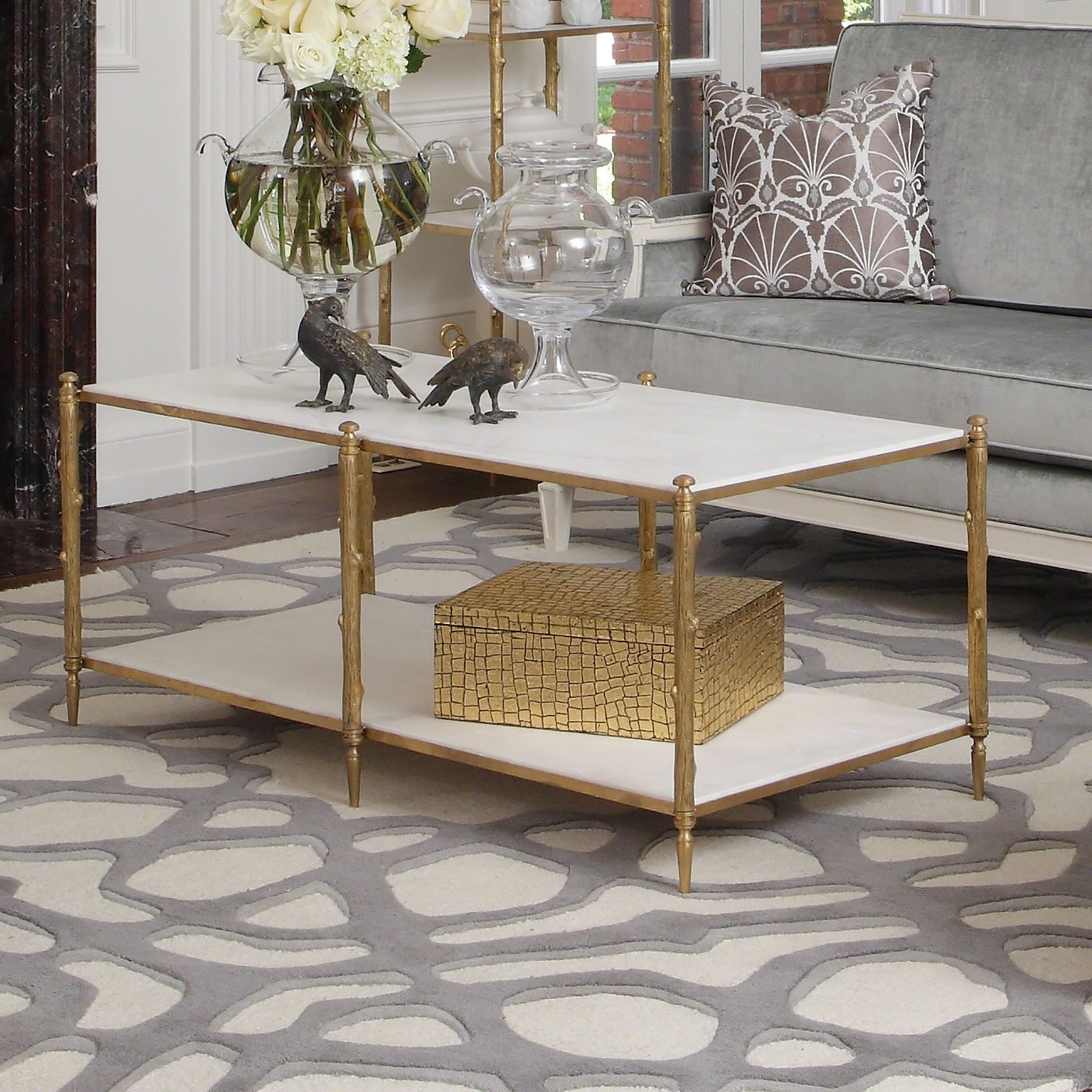 global views arbor cocktail table brass white marble shelves storage rectangle modern
