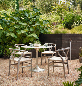Simone Bistro Table raw nickel metal round outdoor view