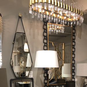 arteriors haskell oval chandelier shown in room
