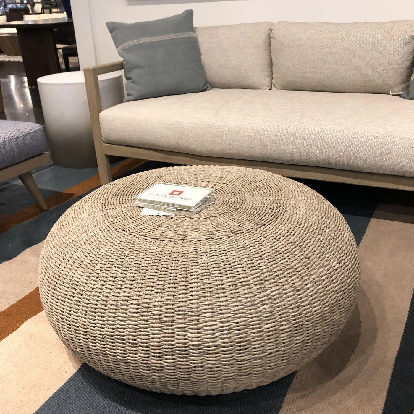 four hands phoenix stool round cushion showroom