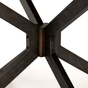 four hands spider round dining table base detail