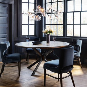 four hands spider round dining table styled