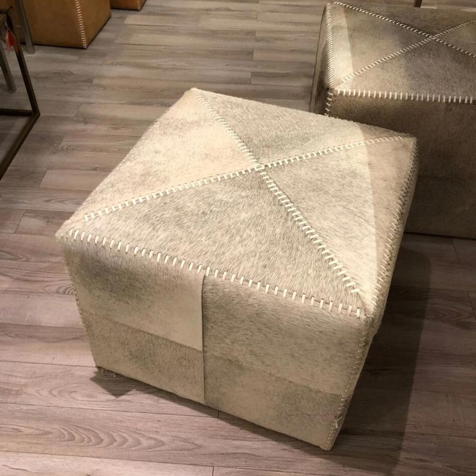jamie young grey hide  ottoman shown in room