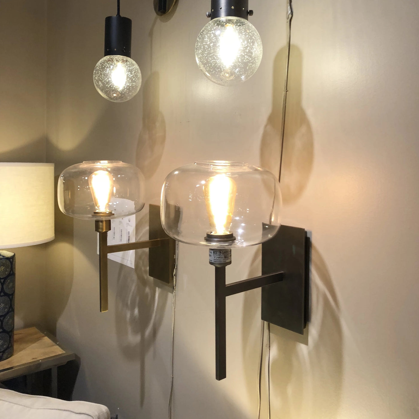 jamie young scando mod sconce showroom wall