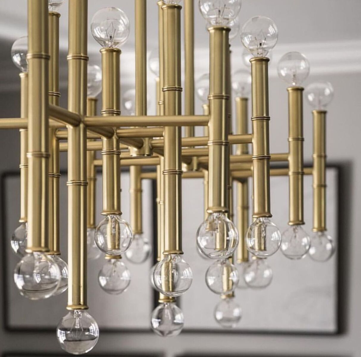 robert abbey meurice brass chandelier in room