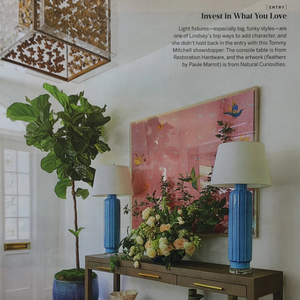 southern living magazine paule marrot feathers entry way over console