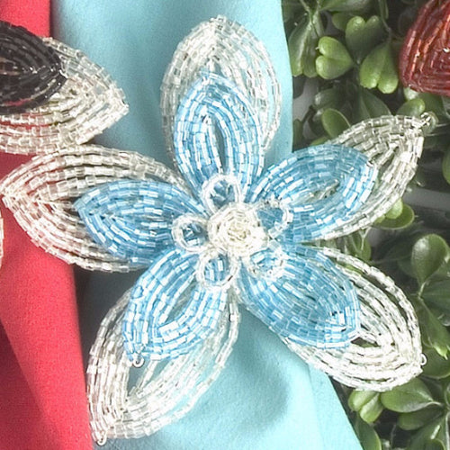 Set of Four Flat Beaded Flower Napkin Rings in Turquoise - Arcadia Home