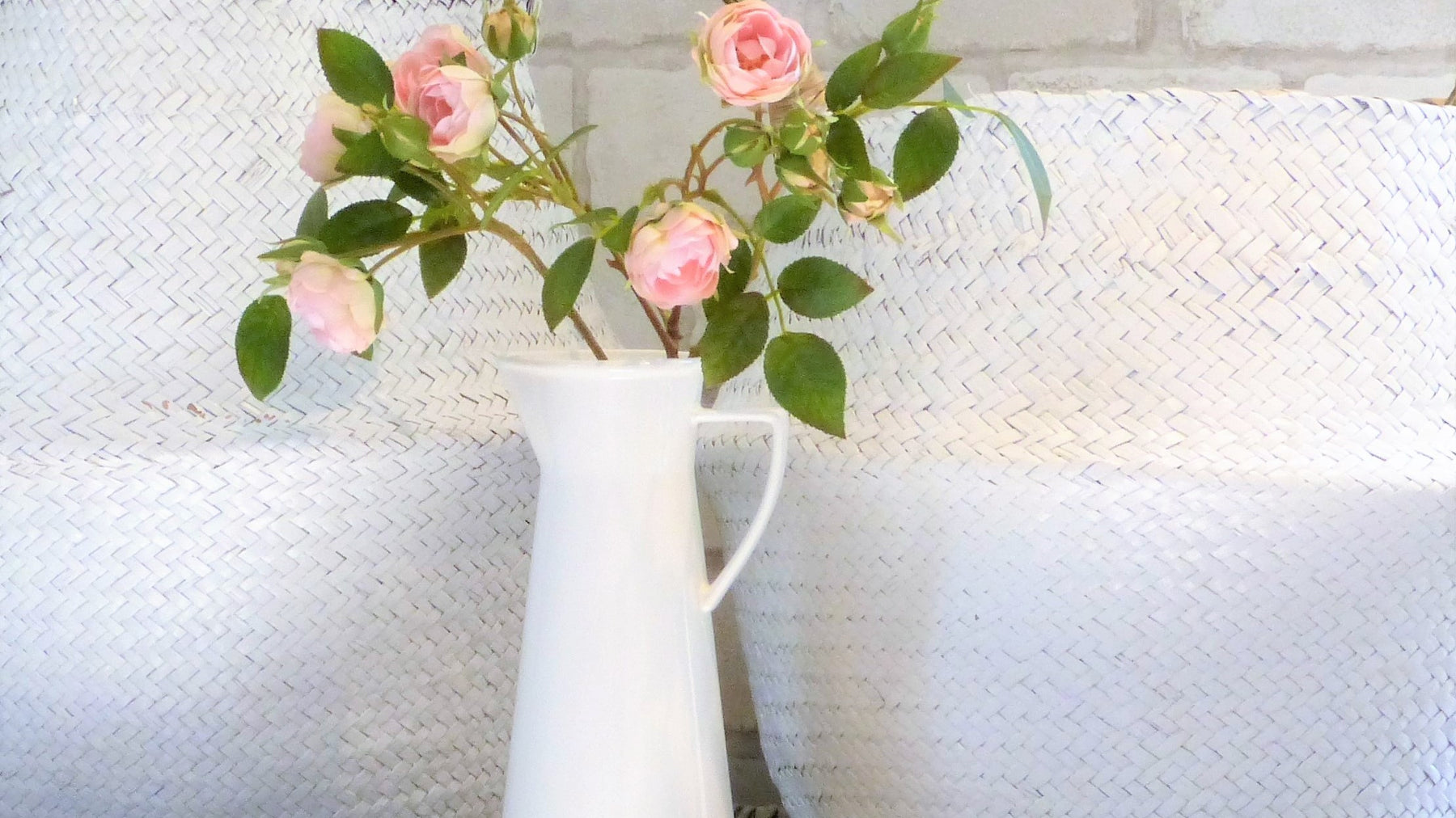 White dipped seagrass belly baskets pink roses white ceramic jug