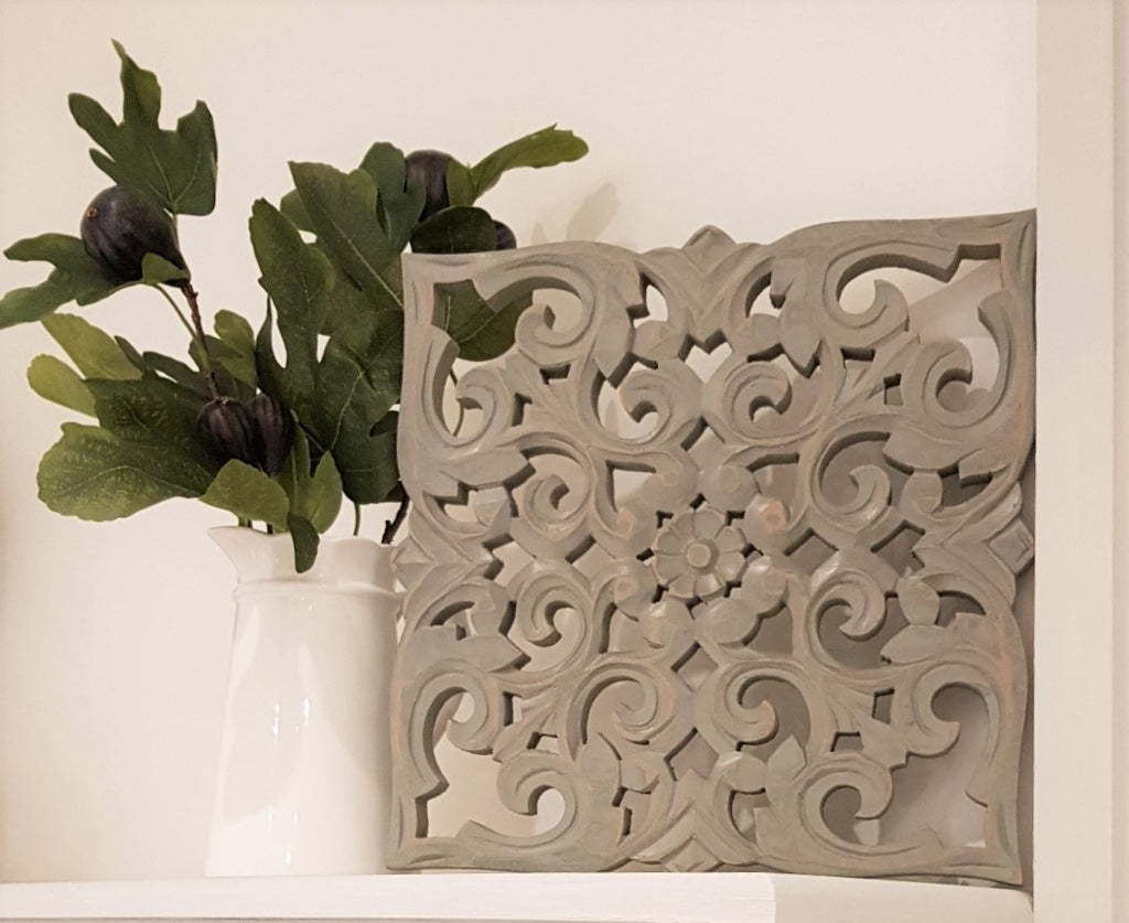 grey wood carved panel