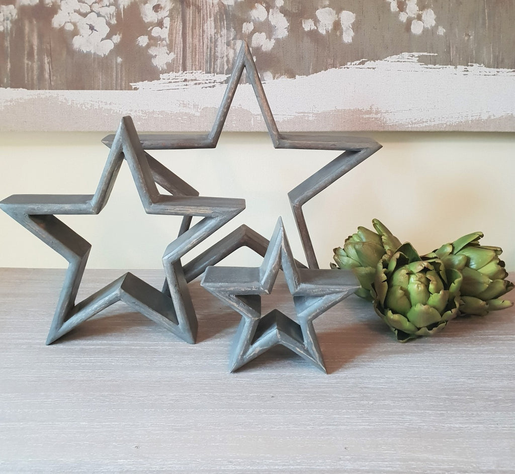 grey wooden mantle star