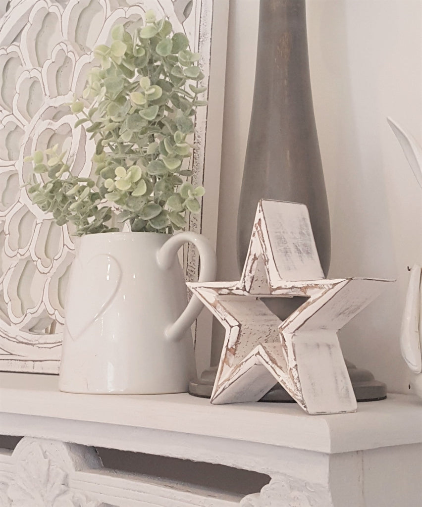 white wooden mantle stars retreat home