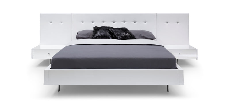 Concavo Bed Queen, white faux leather headboard with crystal buttons, Sideboards and footboard high gloss white, stainless steel legs, with the option of adding panels Behind the night stands