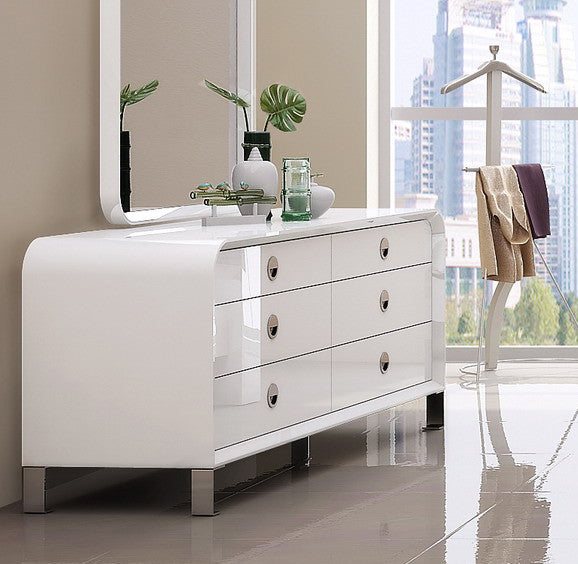Gail Dresser, High gloss white, Stainless steel legs, self close drawers.