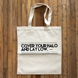 A Bag of Halos & Horns Tote Bags