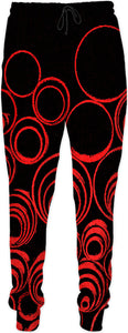 Red circles, scrolls, on black canvas pattern, geometric art design jogging pants