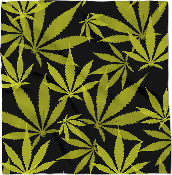 Ganja cut in Fabric yellow and black pattern, cannabis leafs on dark background, legalize maryjane