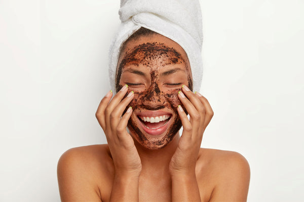smiling woman using a facial scrub