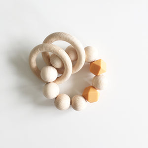 Bezisa Wooden Rattle Teether - Sand Orange - Nursery Edit