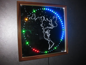 "LED ""handless"" mirror clock with lighted FE map image"