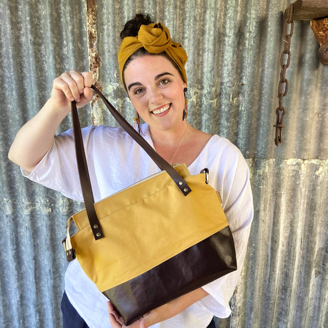 Mustard tote with leather base