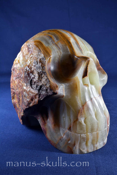 Green-Brown Calcite Manus Skull