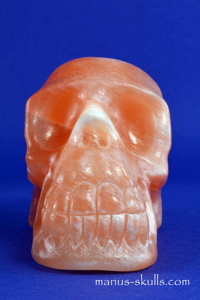 PEACH SELENITE Manus Skull Satin Spar..