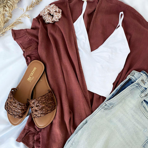 outfit containing a white tank top, madeline girl sandals and a kimono