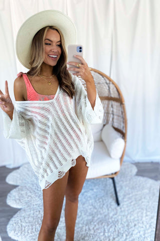Ivory sweater as a swimsuit cover up