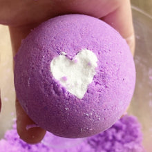 Purple bath bomb with white heart