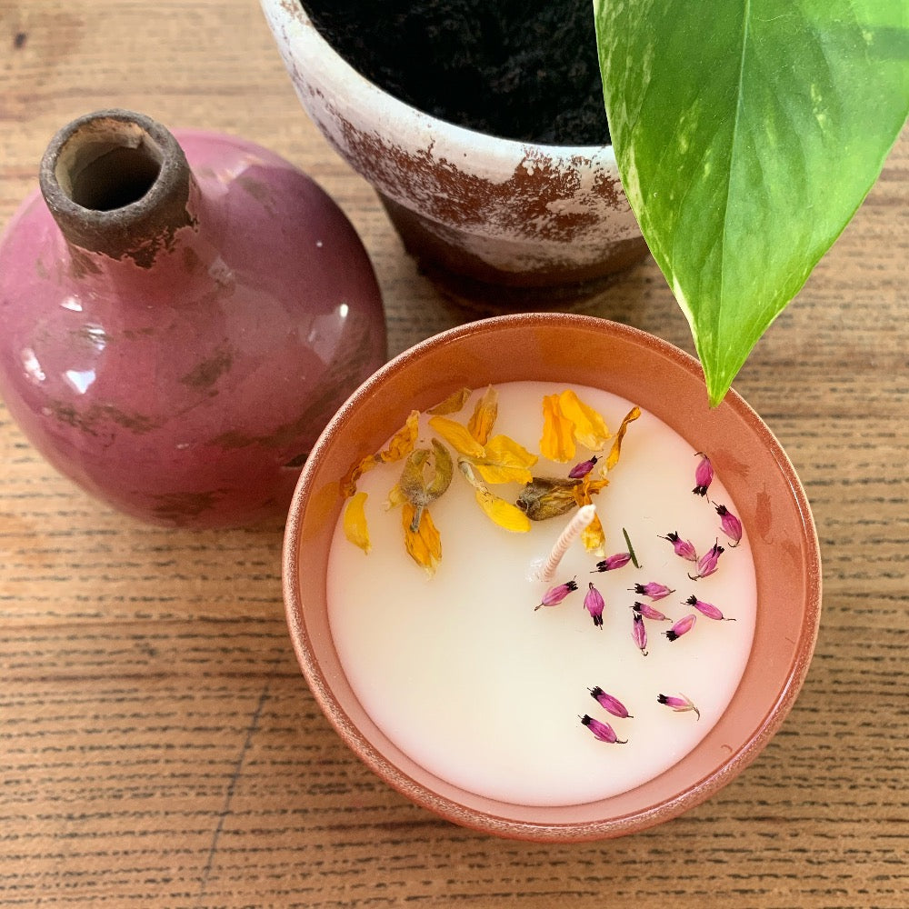 soy wax candle decorated with flower petals