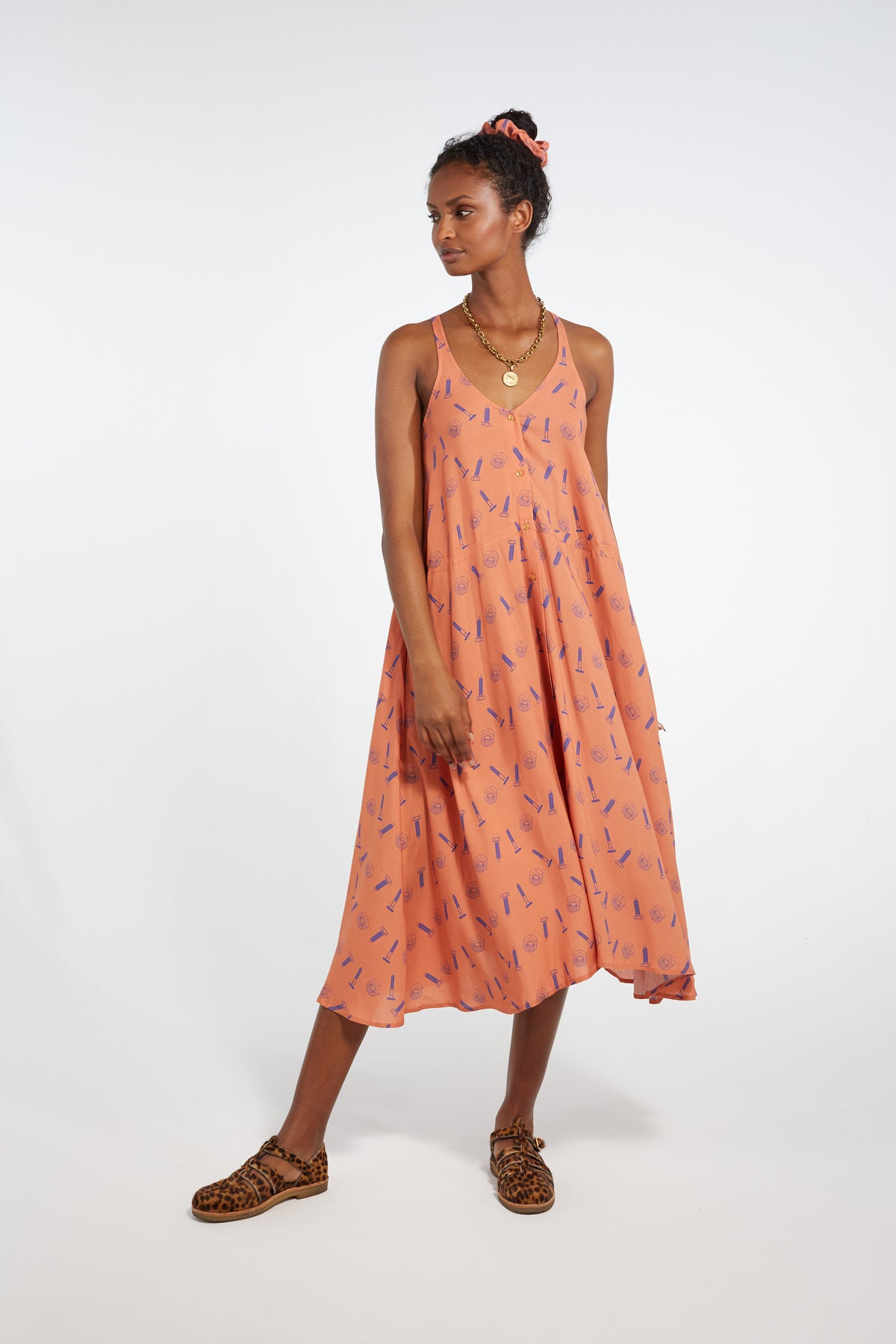 Java dress in orange bolts print