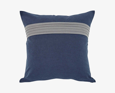 Bold blue pillow with textured grey horizontal stripes