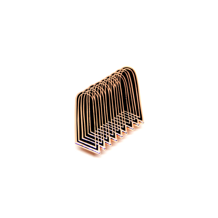 hard enamel pin of overlapping arches, copper colored intricate outlines on black